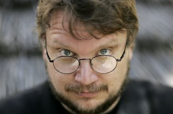 Guillermo del Toro, film director poses for a picture during the 59th International Cannes Film Festival on May 25, 2006 in Cannes, France.  (Photo by MJ Kim/Getty Images) Cannes 2006 Eye Eyeglasses Spectacles Eyewear Accessory Accessories 71045444 Hair Hairy Hairy Face Beard Clothing Outerwear Outer Wear Jacket Jackets Blazer Coat Sportcoat Fashion Descriptives Color Colors Colored Black